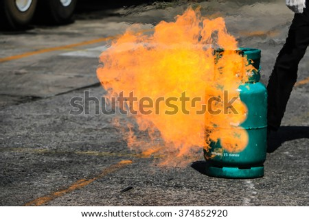 Gas tanks with fire - stock photo