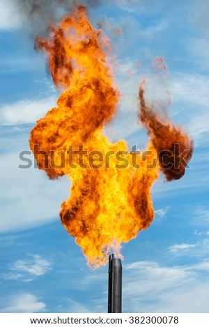 Gas torch. Combustion of associated gas at oil production. - stock photo