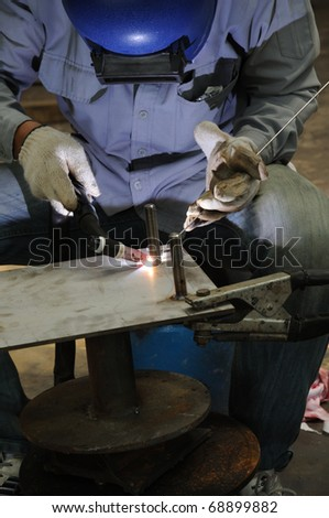 Gas Tungsten Arc Welding (GTAW) is frequently referred to as TIG welding. TIG welding is a commonly used high quality welding process. - stock photo
