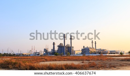 Gas turbine electrical power plant at dusk - stock photo