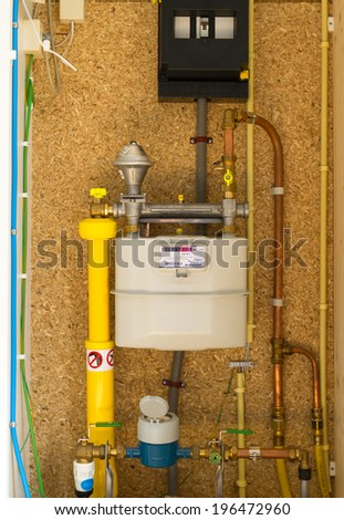 Gas, water and electrical meter on a meter cupboard in a modern home. - stock photo