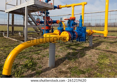 Gas well and valve - stock photo