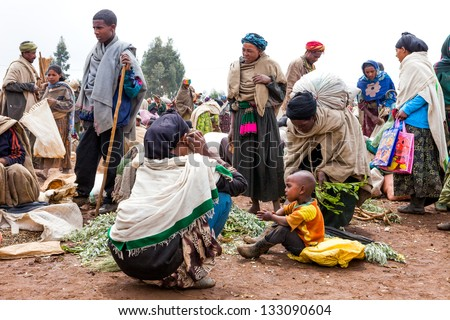 GASENA, ETHIOPIA - AUG 2:  Market scene, gasena weekly market brings together various ethnic groups in the north to exchange or sell their products on Aug 2, 2001 in Gasena, Ethiopia - stock photo