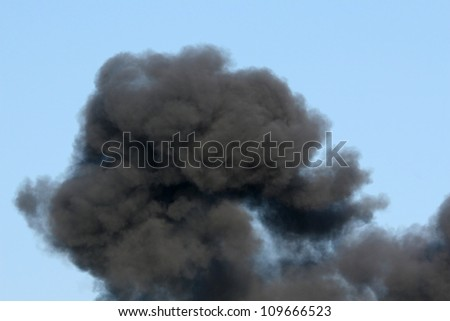 Gasoline and Dynamite Explosion with Billowing Black Smoke