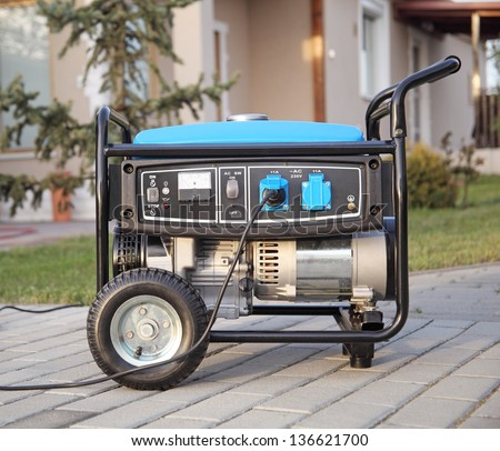 Gasoline powered portable generator at home. - stock photo