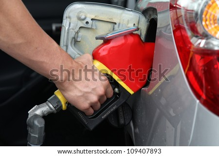 Gasoline pump refilling automobil fuel. Shallow focus.