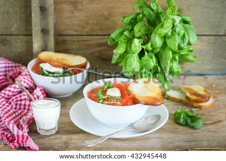 Gaspacho or tomato soup with basil - stock photo