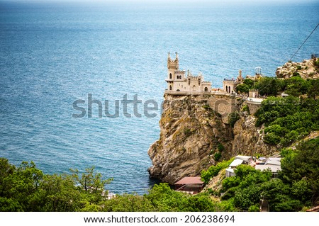 GASPRA - June 27: Beautiful view of old castle in June 27, 2014  in the southern Crimea. The well-known castle Swallow's Nest near Yalta. Gaspra is a popular Crimean resort.   - stock photo