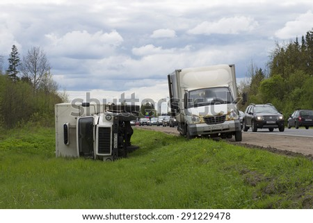 GATCHINA, RUSSIA - MAY 17, 2015: Overturned truck lies on its side on the highway