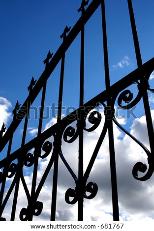 Gate and Clouds - stock photo