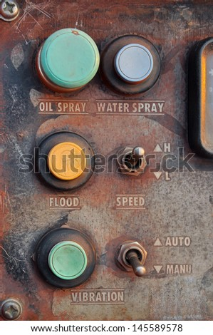 gate and switch on the face of heavy equipment. - stock photo