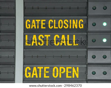 Gate closing,Gate open and last call message on airport information board - stock photo