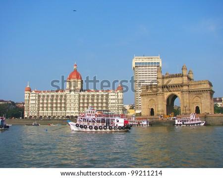 Gate of India and hotel Taj Mahal Palace, Mumbai (formerly Bombay), India - stock photo