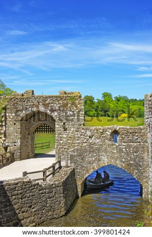 Gate of Leeds Castle which is in the island on the lake in Kent in England. The castle was built in the twelfth century as a king residence. Now it is open to the public. - stock photo