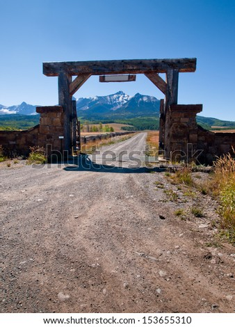 Gate of the Last Dollar Ranch in autumn with a view of the Dallas Divide on the back. - stock photo