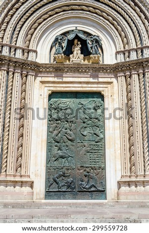 Gate of the Orvieto Gothic Cathedral, Italy - stock photo