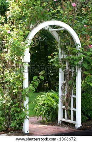 gate or arbor into a garden - stock photo