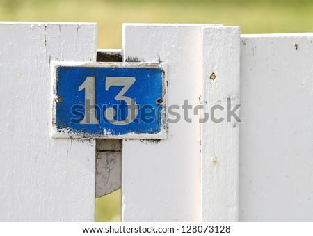 Gate sign, number 13 - stock photo