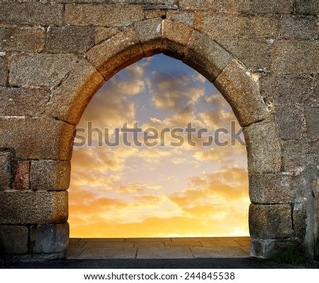 Gate to heaven with the setting sun - stock photo
