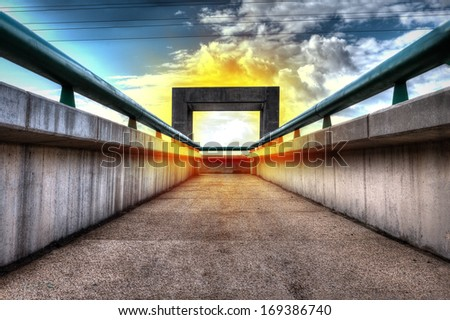 Gate with fire ring in the sky - end of the road - stock photo