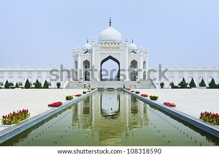 Gate with staircase of a Mosque reflected in a pond at the Hui Cultural Center in Yinchuan, Ningxia Province, China - stock photo