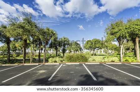 Gated community empty parking lot  in South Florida - stock photo