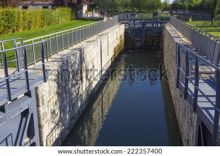 Gates containment of water in a canal - stock photo