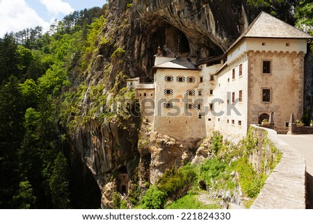 Gates of Predjama castle, build inside the mountain in Slovenia - stock photo