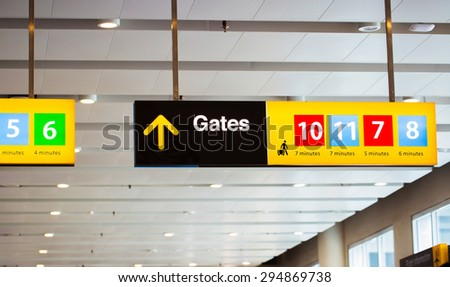 Gates sign at an airport hall with directions and gate numbers - stock photo