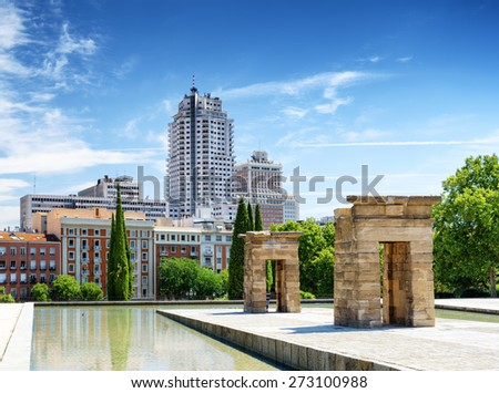 Gates to the Temple of Debod, ancient Egyptian temple, in the Parque del Oeste (Western Park) in Spain. Buildings of Madrid in the background. Madrid is a popular tourist destination of Europe. - stock photo