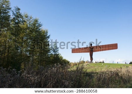 GATESHEAD, UK - OCTOBER 10th. The Angel of the North steel sculpture by Antony Gormley stands 66 feet high with a wing span of 177 feet, on October 10, 2014 at Gateshead, Tyne & Wear, England, UK. - stock photo
