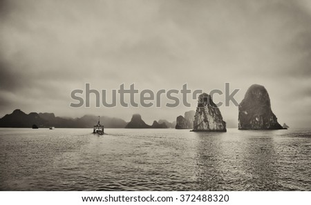 Gathering storm clouds in Halong Bay,Vietnam.  The cruise boats were ordered back to port because of worsening weather conditions - stock photo
