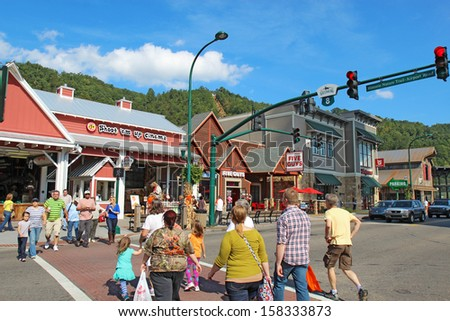 GATLINBURG, TENNESSEE - OCTOBER 6: Tourists and traffic in Gatlinburg, Tennessee on October 6, 2013. Gatlinburg is a major tourist destination and gateway to the Great Smoky Mountains National Park.