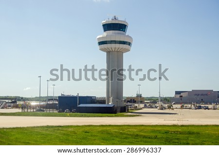 GATWICK AIRPORT, UK - MAY 16, 2015:  The main control tower at London's Gatwick Airport in West Sussex.
