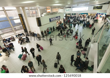 GATWICK, ENGLAND - JANUARY 6. Busy airport at the end of Christmas holidays at Gatwick airport, England on January 6, 2013. Over 34 million passengers passed through Gatwick in 2012. - stock photo