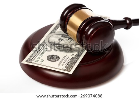 Gavel and banknotes on white background - stock photo