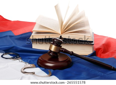 Gavel and books  and russian flag - stock photo