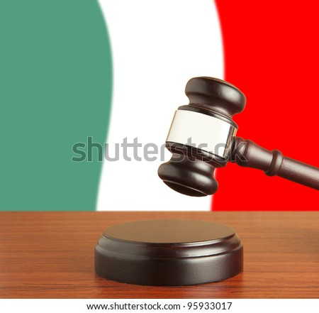 Gavel  and Flag of Italy - stock photo