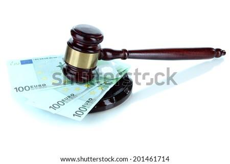 Gavel and money isolated on white - stock photo