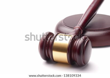 gavel and stand it on a white background - stock photo