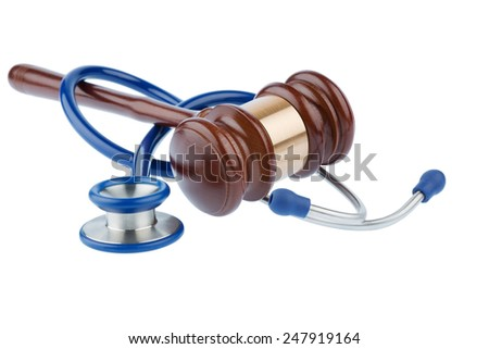 gavel and stethoscope, symbolic photo for bungling doctors and error - stock photo