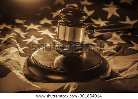 Gavel and wood hammer on US Flag - stock photo