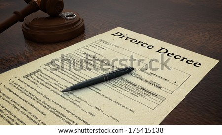 Gavel Divorce Paper Decree Right. Side low shot of a divorce decree paper with a pen, gavel and rings in the scene - stock photo