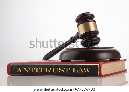 gavel hammer on top of law book