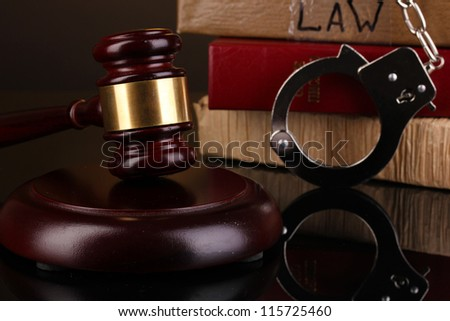 Gavel, handcuffs and books on law isolated on black close-up - stock photo