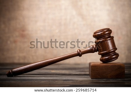 Gavel. Judge's hammer on wooden table  - stock photo