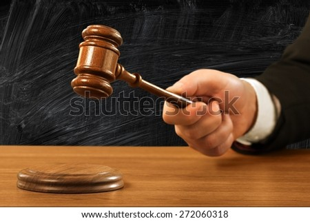 Gavel. Judge's hold hammer on wooden table - stock photo