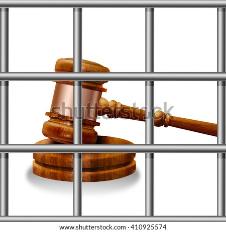 Gavel on a background of the prison bars.Law and Freedom.Prison. - stock photo