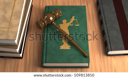 Gavel on a law book with other legal books on the table. Conceptual illustration