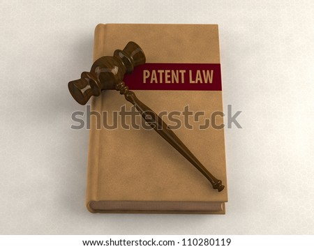 Gavel on a patent law book. Conceptual illustration
